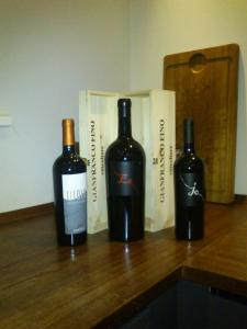 Center: Magnum bottle of Gianfranco Fino's amazing Es 2010, flanked by his Jo 2010 and Elena Fucci's Titolo 2009
